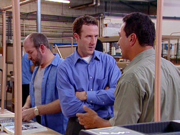 Team members' intense discussion in the warehouse