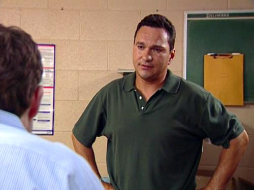 Unhappy team member confronting colleague