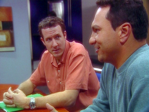 Two team members at a meeting